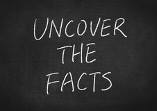 Uncover the facts. Concept word on blackboard background Stock Image