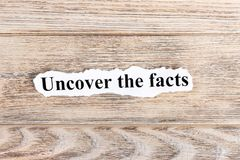 Uncover The Facts text on paper. Word Uncover The Facts on torn paper. Concept Image.  Stock Images