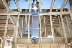 HVAC Duct for Home Ventillation. An uncovered HVAC duct for open air conditioning, heating and cooling duct in the ceiling of an house under construction Stock Photos