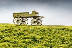 Uncovered wagon retro style in beautiful nature scene farmland Stock Photos