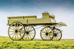 A uncovered wagon retro style in beautiful nature scene. Stock Photos