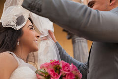 Uncovering a bride's veil Stock Photography