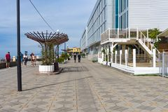 Uncrowded seaside promenade in the resort town in autumn. Sochi, Russia-October 11, 2016: Uncrowded seaside promenade in the resort town in autumn Royalty Free Stock Photos