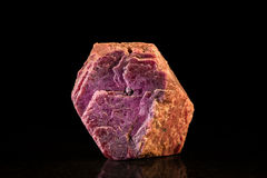 Uncut ruby in front of Black royalty free stock photos