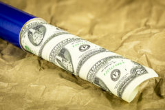 Uncut sheet of money in a blue tube Royalty Free Stock Photos