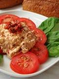 Und Frischkäse de MIT Tomaten d'immersion Photographie stock libre de droits