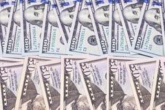 100 und 50 US-Dollar Zusammenfassungshintergrund Lizenzfreie Stockfotos