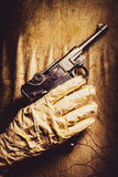 Undead Mummy  Holding Handgun Against Wooden Wall Royalty Free Stock Image