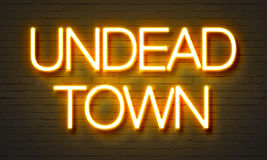 Undead town neon sign on brick wall background. Royalty Free Stock Photos
