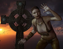 Undead woman in front of a cross on the sea Royalty Free Stock Images