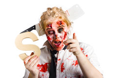 Undead woman with S sign. An undead zombie costumed woman holding a S sign in her hand Stock Image