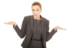 Undecided blond business woman. Business woman making undecided gesture Royalty Free Stock Photo