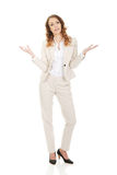 Undecided business woman. Business woman making undecided gesture Royalty Free Stock Photos