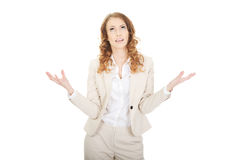 Undecided business woman. Business woman making undecided gesture Stock Image