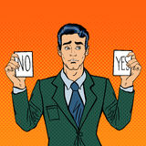 Undecided Businessman Making Decision. Man Holding Cards Yes No. Pop Art Stock Photo