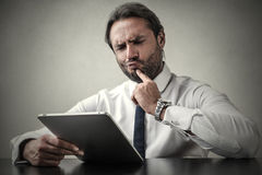 Undecided businessman. Weighing different options Royalty Free Stock Image
