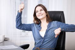 Undecided businesswoman doing a thumbs up and down Royalty Free Stock Photography