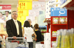 Undecided customers at supermarket stock image