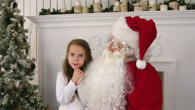 Undecided little girl on Santa Claus lap thinking about her present. Professional shot on Lumix GH4 in 4K resolution. You can use it e.g. in your commercial stock video footage