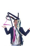 Undecided man with lot of ties around him Royalty Free Stock Photos