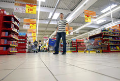Undecided shoppers at supermarket Stock Image