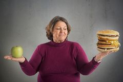 Undecided start diet. Woman undecided whether to start the diet Royalty Free Stock Photography