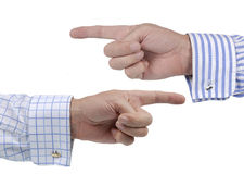 Two hands pointing in different directions, confusion or argument concept Stock Photography