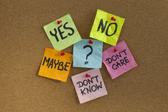 Undecided voter concept. Colorful sticky notes on cork bulletin board Royalty Free Stock Photos