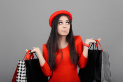 Undecided  Woman with Shopping Bags Stock Photos