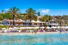 Undefinable People relaxing on Coral Bay Beach, one of the most famous beaches in Cyprus Stock Photos