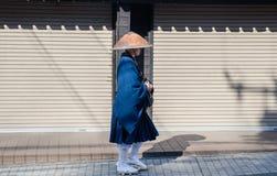 Undefined japanese monk walk on Kamakura`s city street. Japan royalty free stock photos