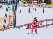 An undefined little skier in the ski lift Stock Photos