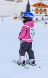 An undefined little skier before the start of the competition Royalty Free Stock Photos