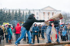 Undefined men with sacks take part in a fight contest during celebration of Maslenitsa. Royalty Free Stock Image