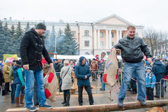 Undefined men with sacks take part in a fight contest during celebration of Maslenitsa. Stock Photo