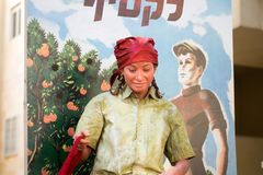 Undefined oranges harvester girl participant of Rehovot International Live Statues Festival (On banner written to harvest royalty free stock photography