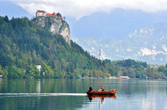 Undefined people in the boat on Bled lake Royalty Free Stock Photography