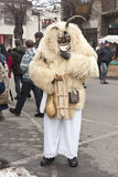 Undefined people in mask at a carnival. Carnival in MOHÁCS, HUNGARY - FEBRUARY 19: Undefined people in mask at the carnival of funeral the winter on February 19 Stock Image