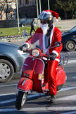 Undefined Santa delivering humanitarian aid in form of gifts to disabled children during annual Santa Claus Motorcycle Parade on 2 Royalty Free Stock Photo