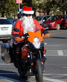 Undefined Santa delivering humanitarian aid in form of gifts to disabled children during annual Santa Claus Motorcycle Parade on 2 Royalty Free Stock Image