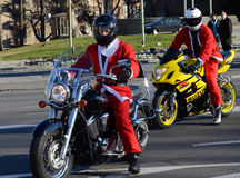 Undefined Santa delivering humanitarian aid in form of gifts to disabled children during annual Santa Claus Motorcycle Parade on 2 Royalty Free Stock Images