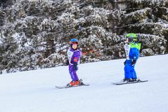 An undefined small skiers on the track of the competitionin Stock Photography