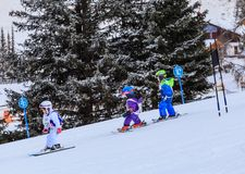 An undefined small skiers on the track of the competitionin Royalty Free Stock Image