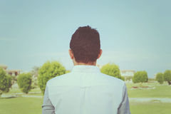 Undefined teenager in park. Royalty Free Stock Image