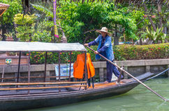 Undefined villager pading the traditional thai wooden boat at Klong Lat Mayom Float Market on April 19, 2014 in Bangkok Royalty Free Stock Photo