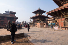 Undentified man use mobile in Patan Durbar square Royalty Free Stock Image