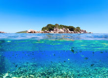 Under and above water. Photo of small island in Seychelles Stock Image