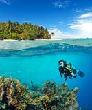 Under and above water surface view of woman diver royalty free stock photography