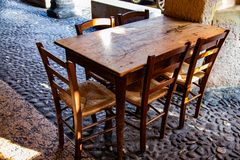 Old wooden chairs and table in a quiet restaurant royalty free stock images