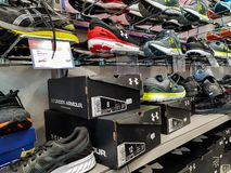 Under Armour sport shoes in  local store. stock photo